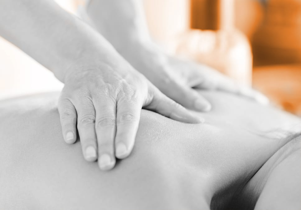 Attractive Woman Having A Massage With Massage Oil In A